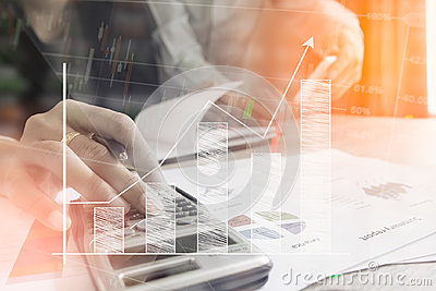 Businessman check seriously analyzes a finance report investor colleagues discussing new plan financial graph data. bank managers