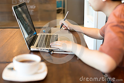 stock image of student graphic design hand drawing on pen mouse pad