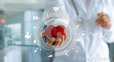 Doctor holding red heart shape in hand and icon medical