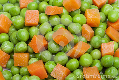 detail of peas and carrot in squares