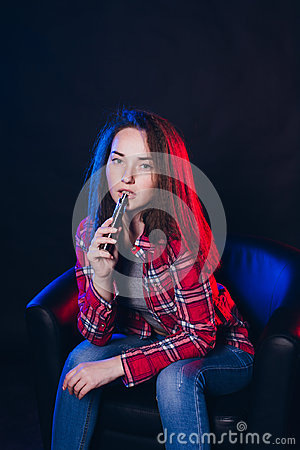 Woman smoking electronic cigarette with smoke