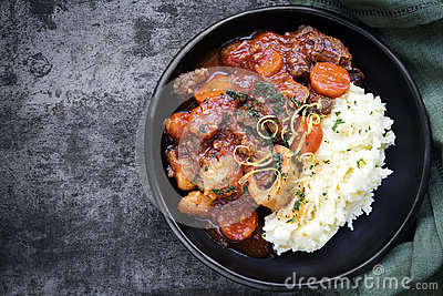 Osso Bucco Beef Stew with Potato Mash Top View on Slate