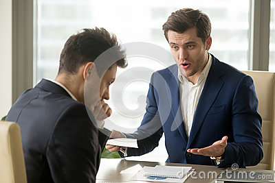 Boss yelling at employee for missing deadline, bad work results