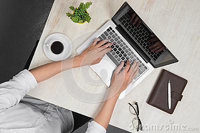 Top view of man using a modern portable computer in home office