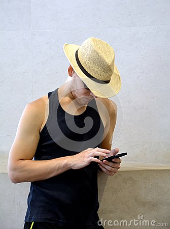 Handsome young man traveling on Kyoto and looking at his mobile phone.