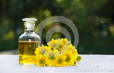 Essential floral oil. Flower elixir and fresh summer flowers. Spa and beauty care.