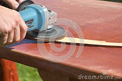 The Sanding wooden table carpenter working