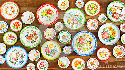 Colorful asian style plates on wooden wall texture background, i
