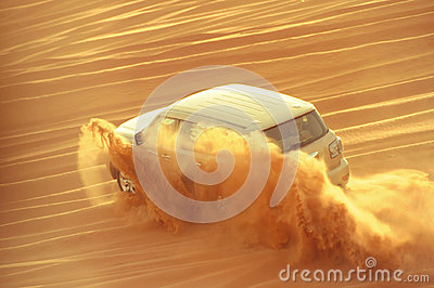 A 4-wheel drive car in action in a desert safari trip in Dubai-UAE on 21 July 2017.