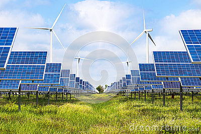 Solar cells and wind turbines generating electricity in power station alternative renewable energy
