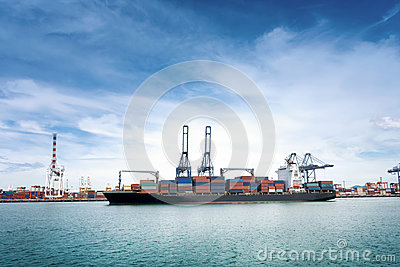 Logistics and transportation of International Container Cargo ship with ports crane bridge in harbor for logistic import export ba