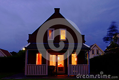 Cozy holiday home with veranda lighted by night