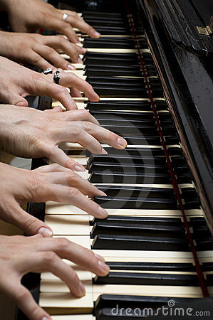 Six hands on piano