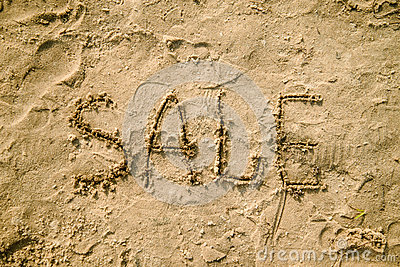 Sale written in the sand on a beach