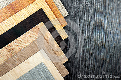 Wood texture. Surface of teak wood background for design. Samples of laminate and vinyl floor tile on wooden Background.