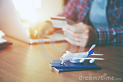 Airplane with passports near paying with credit card
