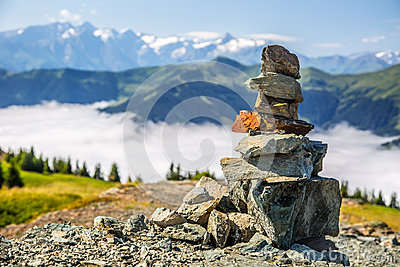 Pyramid made by stones and austrian alps in the backtound. Photo taken on Asitz moutain in Leogang Salzburg