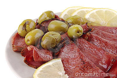 Sliced served sausage with raw lemon