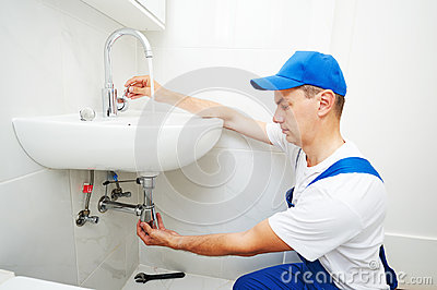 Plumber man repair leaky faucet tap