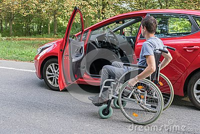 Accessibility concept. Handicapped or disabled man on wheelchair near car