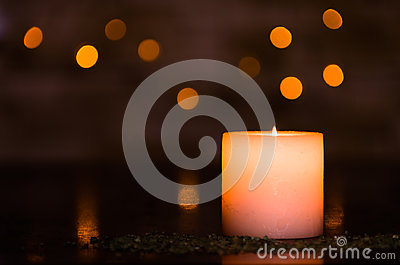 Moody candlelight with a nice fuzzy light bokeh. Perfect for the spa.