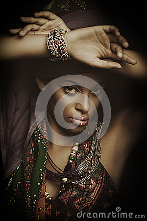 African black young woman beauty portrait with turban studio sho