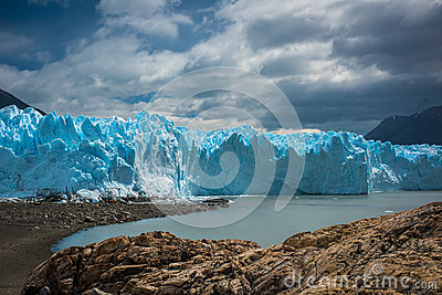 A huge blue glacier near the bay. Shevelev.