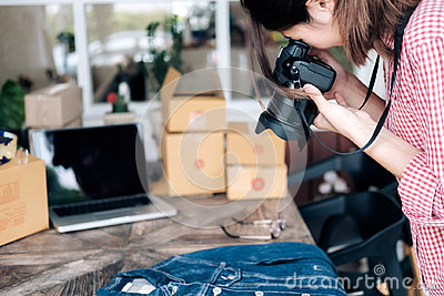 Online seller take a photo of product for upload to website onli