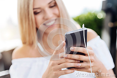 Modern smartphone being used for listening to music