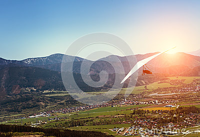 Hang-glider fly over mountain valley
