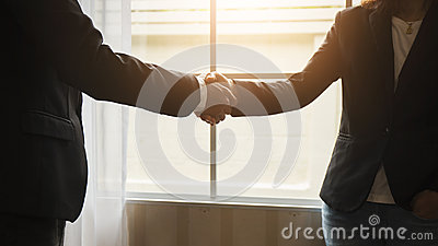 Handshake between attorneys and clients after agreeing to enter into a contract