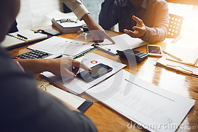 Co-workers are consultants on business documents, tax