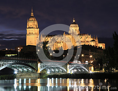 Salamanca skyline at night in Enrique Estevan bridge over Tormes River