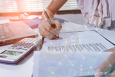Double exposure business people working at office. Stock markets financial or Investment strategy background Business chart