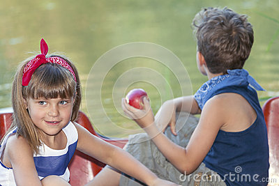 Two happy kids playing on the boat at summer day