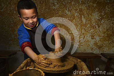 Kid making pottery