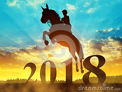 Silhouette the rider on the horse jumping into the New Year 2018.