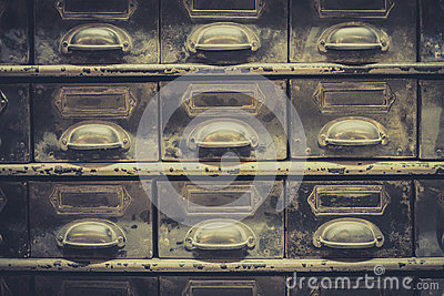 Archive concept, vintage library drawer closeup, retro filter