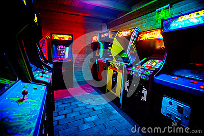 Room full of of 90s Era Old Arcade Video Games in Gaming Bar