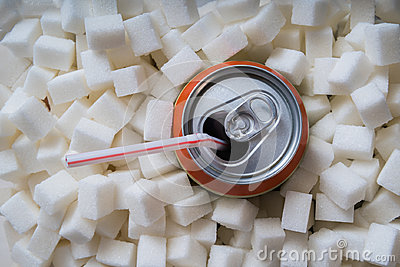 Carbonated soda drink with many sugar cubes. Unhealthy eating concept