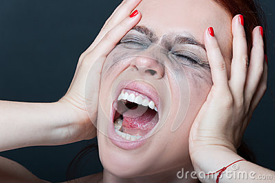 Woman with smeared mascara screaming