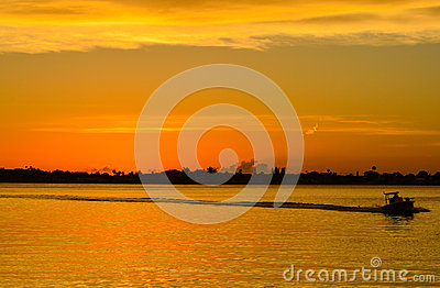 Sunset with the silhouette of a boat on the inter coastal in Belleair Bluffs, FloridaSunset with the silhouette of a boat on the i