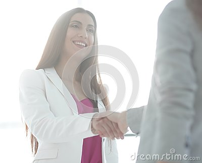 Handshake, business woman and client
