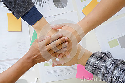 business cooperate hands join on office desk.
