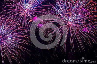 Close-up of vivid purple fireworks with sparks. Explosive pyrotechnic devices for aesthetic and entertainment purposes