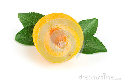 Half yellow plum with leaves isolated on white background