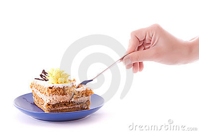 Hand with spoon snap off a peace of cake