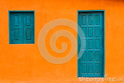 Colorful and Simple Orange Facade with Blue Greenish Door and Windows