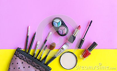 Cosmetics and fashion background with make up artist objects: lipstick, eye shadows, mascara ,eyeliner, concealer, nail polish