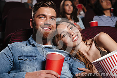 Close up of a smiling young couple watching movie